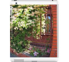 Facade of the building with a brick wall with flowers iPad Case/Skin