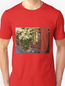 Facade of the building with a brick wall with flowers T-Shirt
