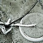 Bike in mud by markheathcote