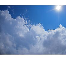 Dark clouds, blue sky and bright sun Photographic Print