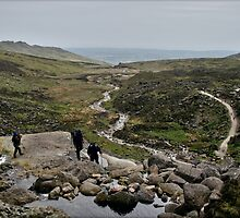 Hill walkers @ Mahon Falls, Waterford, Ireland by John  Carey
