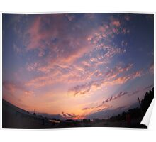 Skies and clouds over the city at sunset Poster