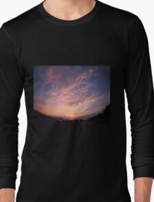 Skies and clouds over the city at sunset Long Sleeve T-Shirt
