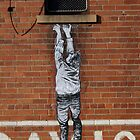 hanging man by baby  guerrilla