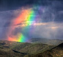 Violent Rainbow -- Sunset storm in the Sangre de Cristos by njordphoto