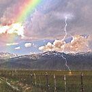 Bridgeport, Ca, with lightning,rainbow, and rain by the57man