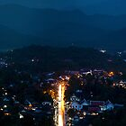 Night Rain over Luang Prabang - Laos by Cameron Christie