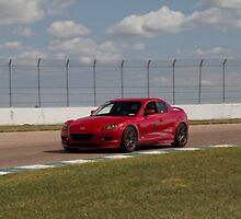 Trevor K. Silva's Mazda RX8 at the Heartland Park Topeka Road Course by Paul Danger Kile