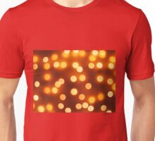 Abstract defocused and blur bokeh of small yellow lights Unisex T-Shirt