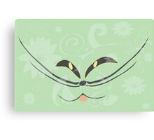 Muzzle of a smiling cat on a light green background Canvas Print