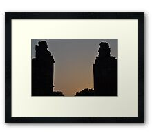 Sunset through a ruin Framed Print
