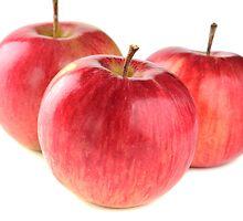 three ripe red apple on white background by Valerii Kotulskyi