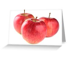 three ripe red apple on white background Greeting Card