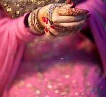 Putting on Bangles by naureen bokhari