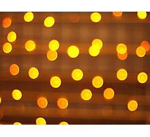 Blur image of yellow round light bulb Photographic Print
