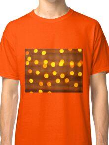 Blur image of yellow round light bulb Classic T-Shirt