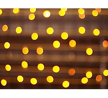 Defocused and blur image of yellow round light bulb Photographic Print