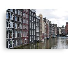 Amsterdam buildings and canal. Canvas Print
