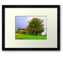 A house on the hill Framed Print