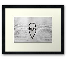 Heart shadow with rings on a book Framed Print