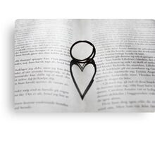 Heart shadow with rings on a book Canvas Print