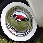 Hub cap reflections, Goodwood Revival, 2011 by herbpayne