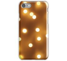 Blur image of yellow round light bulb iPhone Case/Skin