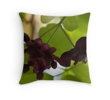 Burgundy against the green Throw Pillow