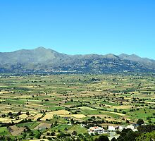 View of the fertile Lassithi Plateau in Crete, Greece. by FER737NG