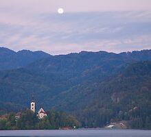 Moon setting at sunrise Lake Bled by Ian Middleton