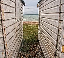 In Between beach huts - Cooden by Paul Morris