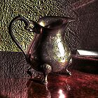 The silver milk jug by Richard Ray