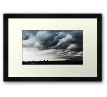 The clouds rollin' into NYC Framed Print