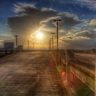 Sunset from a Parking Garage roof by njordphoto