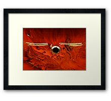 satellite crossing a flaming planet Framed Print