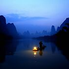 A fisherman on Li River, Guangxi, China   by maysun