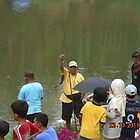 A fisherman shows his catch by onkytombe