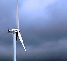 Wind Turbine Against Dark Clouds by Peggy Berger