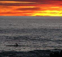 Canoer at sunset by jmccabephoto