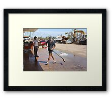 Shop Owners clean up after Cyclone Yasi - Cardwell, North Queensland, Australia Framed Print