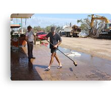 Shop Owners clean up after Cyclone Yasi - Cardwell, North Queensland, Australia Canvas Print