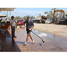 Shop Owners clean up after Cyclone Yasi - Cardwell, North Queensland, Australia Photographic Print