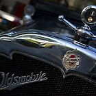 Oldsmobile by Marius Brecher