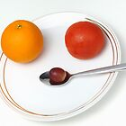 Plate and spoon with one Orange, one tomatoe, one grape by Sami Sarkis