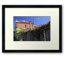 Old Brick Building, Wooden Fence and Flowers Framed Print