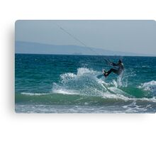 Kite surfer jumping over a wave, Playa de los Lances, Tarifa, Spain. Canvas Print