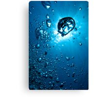 Air bubbles underwater illuminated by sunbeams, Marseille, France. Canvas Print