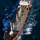 Oil tanker at sea, aerial view, Fos sur Mer, France. by Sami Sarkis