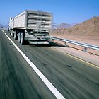 Egypt, Sinai Desert, lorry on highway (blurred motion) by Sami Sarkis