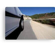 Speeding  car on road Canvas Print